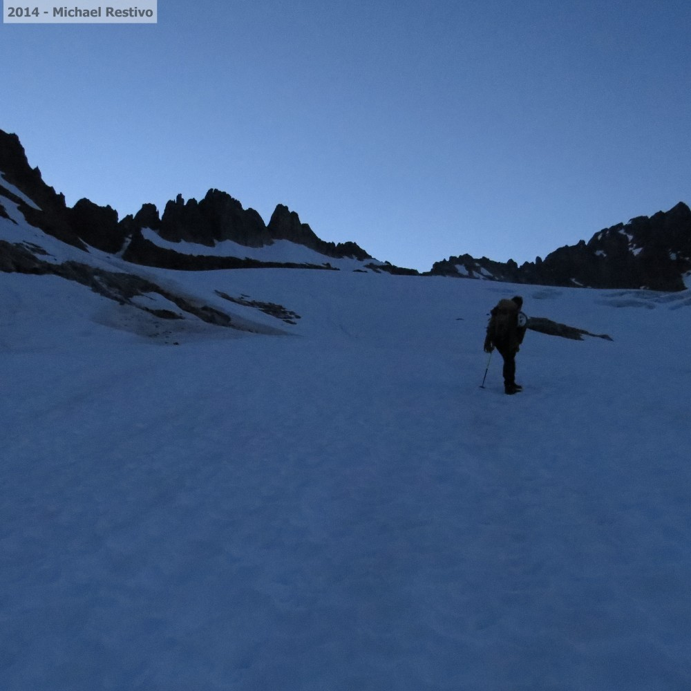 Climbing the snowfield towards Sharkfin Tower