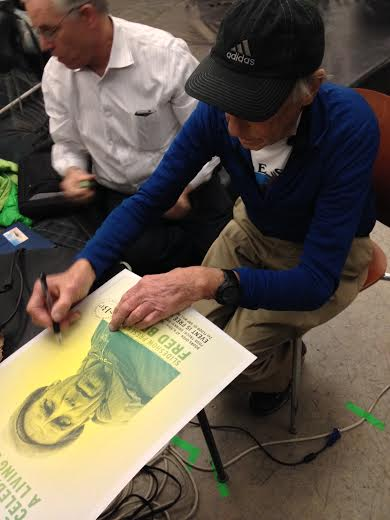 Fred signs my poster at the Seattle Bouldering Project last December